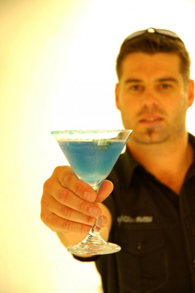 Photo of a barman offering a drink