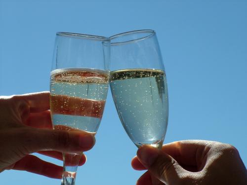 Photo of champagne glasses clinking