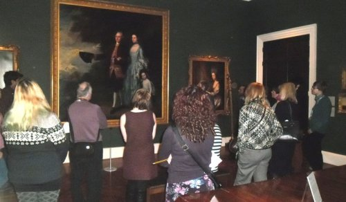 Group looking at a painting