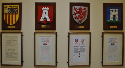 Four plaques of twinned towns