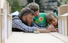 Image of a family helping to build a cardboard model of Pulteney Bridge