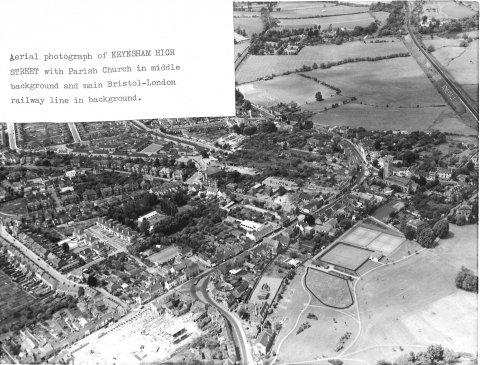 Aerial view Keynsham Highstreet with parish church and bristol-london railway