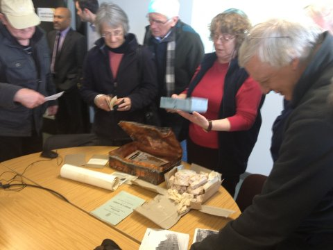 People looking at time capsule contents