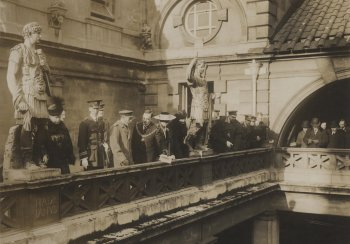 Image: King George V, Queen Mary and civic dignitaries on the balcony overlooking the Great Bath in Bath in 1917