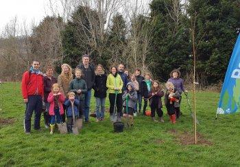 Volunteers planting trees at Kensington Meadows