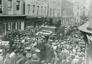 Image: black and white photograph of crowds gathered in New Bond Street celebrating peace in 1918