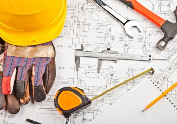 builders hat, hammer and plans