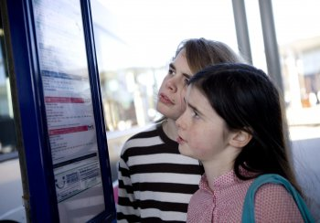 Girls looking at bus timetable