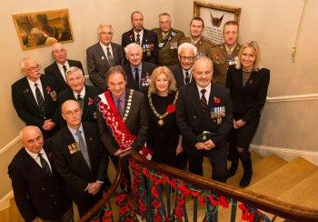 Image of guests at the unveiling of a WW1 plaque in the Guildhall, Bath