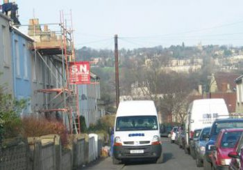 Scaffolding erected against a residential property