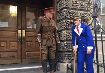 Image of two actors dressed as World War One wounded soldiers on steps of Guildhall in Bath
