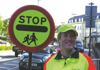 School Crossing Patrol Person with Sign