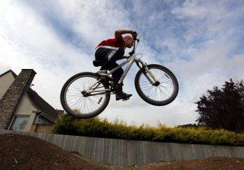 boy on bmx in the air