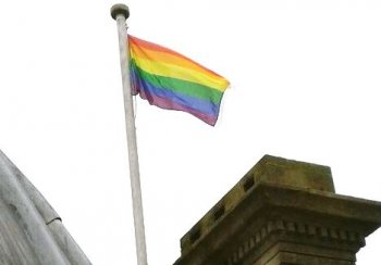 Rainbow flag flying above the Guildhall