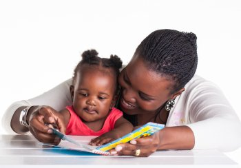 Mother and baby reading a book together
