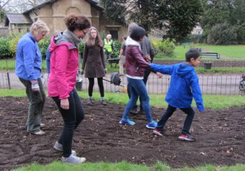 Volunteers stamping the wildflower seed into the earth