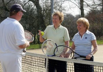 Tennis coaching with two lady players