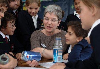 Photo of teacher with children in class activity