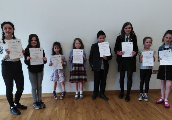 Photo of the 8 shortlisted entrants, holding their certificates