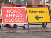 Image of road closed and diversion signs