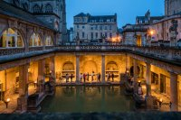 torchlit roman baths