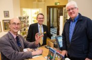 of Cllr Paul Crossley (left) getting his annual pass at the Victoria Art Gallery with the help of Manager Jon Benington (centre) and Visitor Services Supervisor Martin Luscombe.