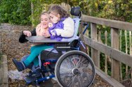 Rainbow resource child outdoors in wheelchair